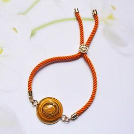 Bohemian woman bracelet, adjustable, on orange nylon cord, yellow spiral in polymer clay, handmade, Joanna Calla
