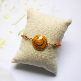 Orange cord bracelet yellow spiral