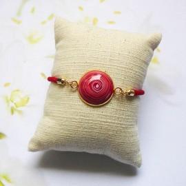 Red cord bracelet red spiral