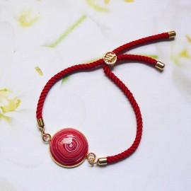 Bracelet bohème femme réglable sur cordon en nylon rouge, spirale rouge en argile polymère, fait main, Joanna Calla