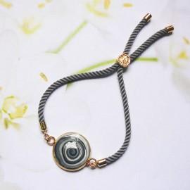 Bohemian woman bracelet, adjustable, on grey nylon cord, black spiral in polymer clay, handmade, Joanna Calla