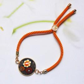 Bohemian woman bracelet, adjustable, on orange nylon cord, brown flowers in polymer clay, handmade, Joanna Calla