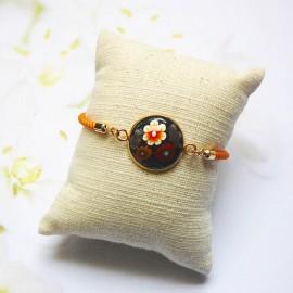 Orange cord bracelet brown flowers