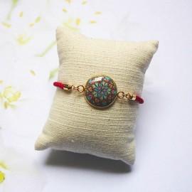 Bracelet cordon rouge mandala bleu rouge